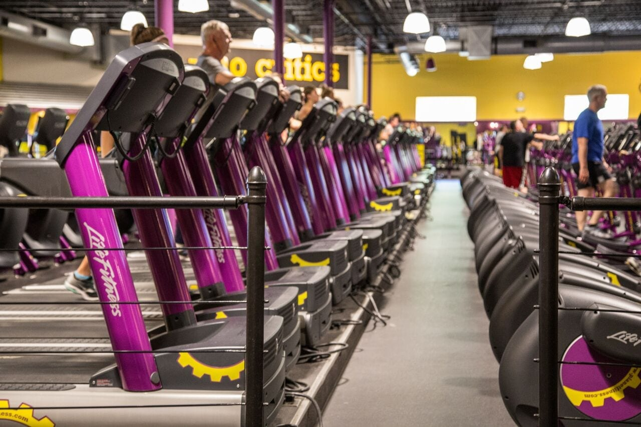 National Fitness Partners acquires 12 Planet Fitness club.